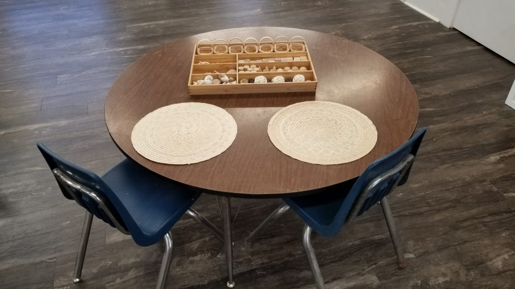 Tray of different items on a table. Children First Preschool, Denton TX.