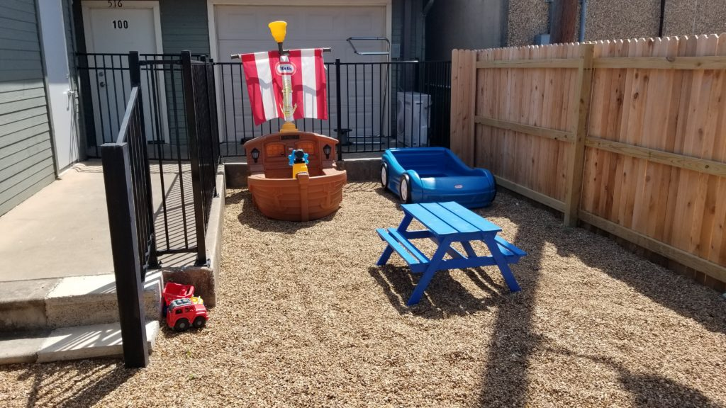 Playground of race car, pirate ships, and picnic table. Children First Preschool, Denton TX.