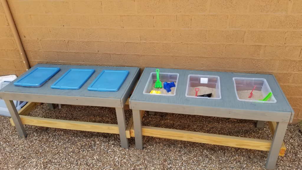 Sand and water tables with toys at Children First Preschool Denton TX